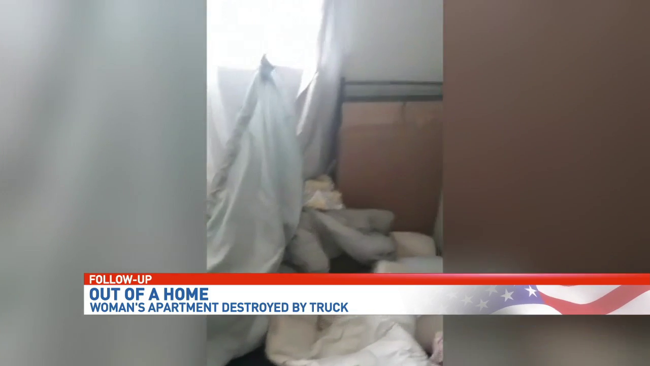 Mother looking for new home after truck leaves hole in her apartment