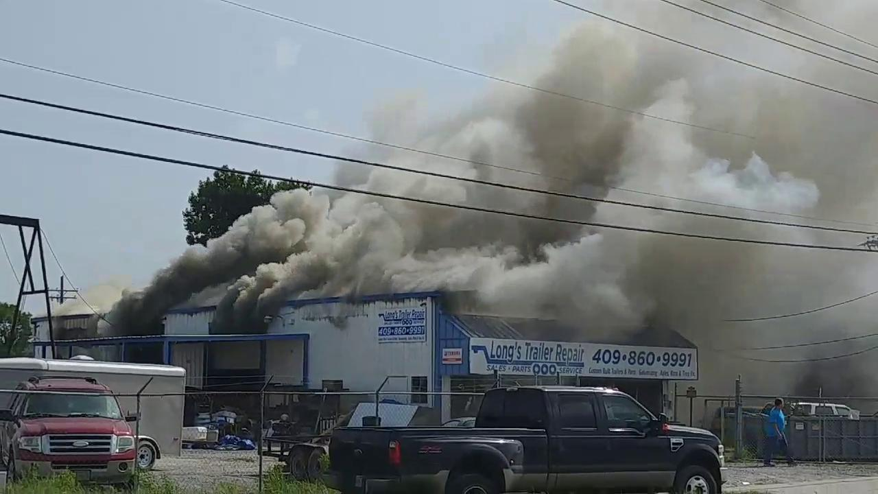 Fire, thick smoke pour through College Street business