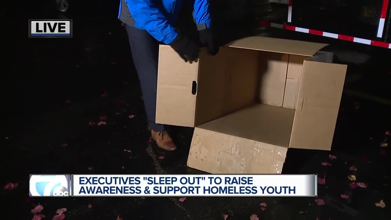 Business executives sleep outdoors to raise awareness of