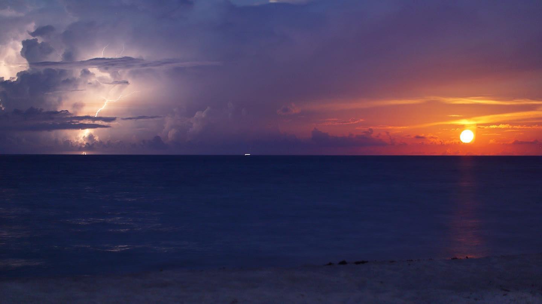 Amazing moonrise caught alongside lightning strike off