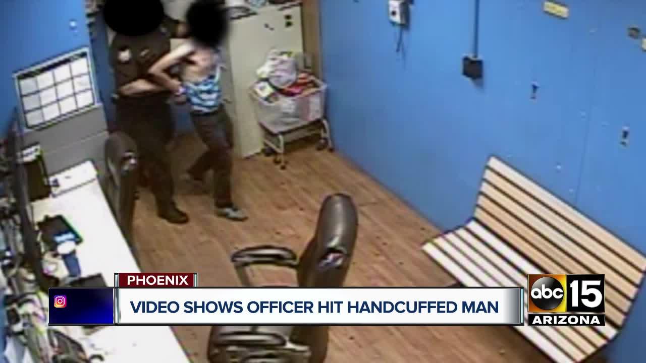 WATCH: Store video shows Phoenix officer slap handcuffed man
