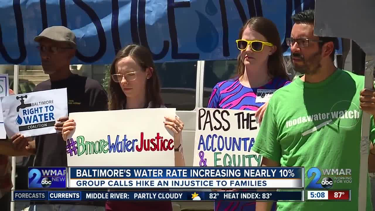 Residents rally outside City Hall for water bill hike