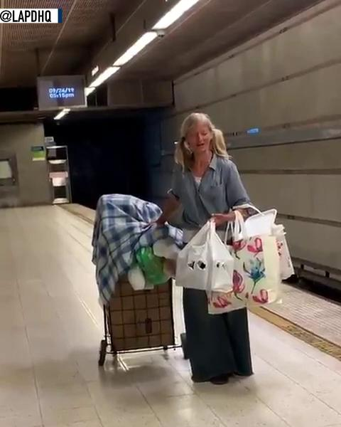Woman sings opera in a Los Angeles subway station