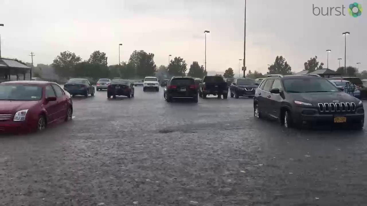 WATCH: Evening rain turns DeWitt Wegmans parking lot into small lake