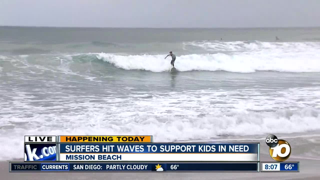 6a99404264 Surfers hit waves to support kids in need