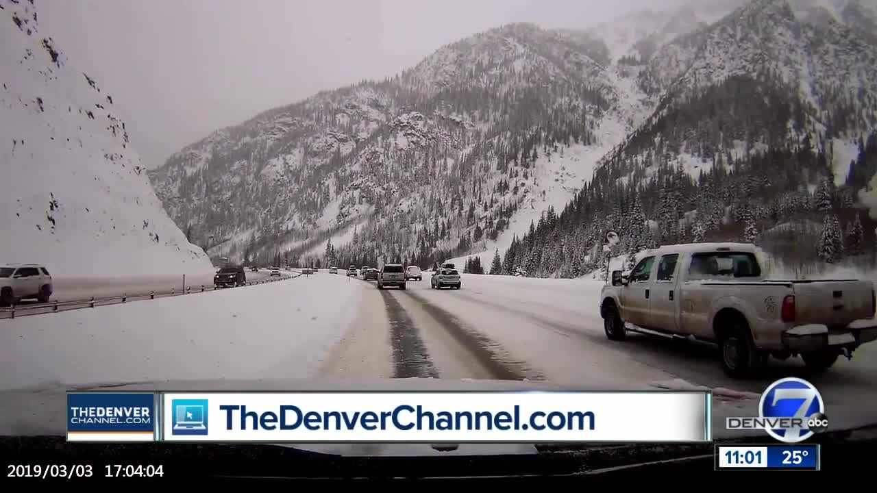 Video captures avalanche in Colorado roaring onto highway, covering cars with snow