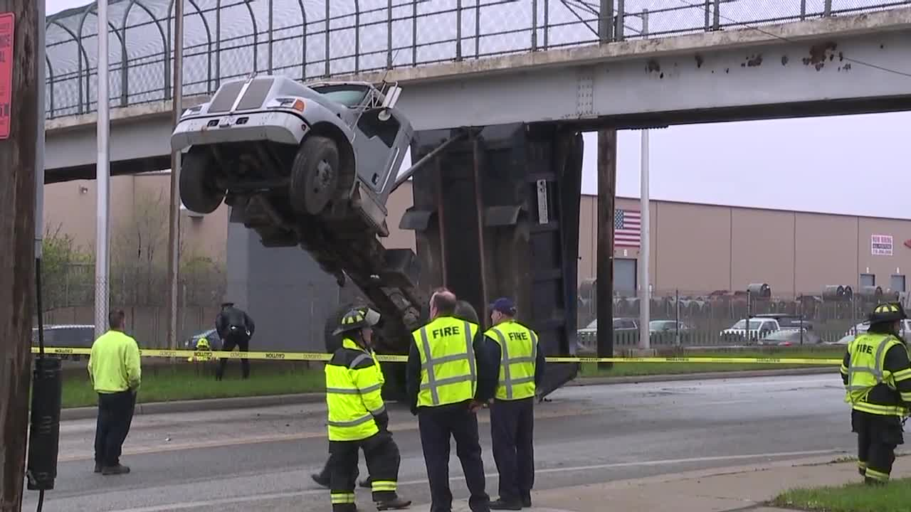Dump truck removed after hitting pedestrian bridge on East 49th