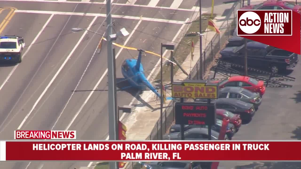 Helicopter crashes onto busy Tampa highway, rotor blade hits truck