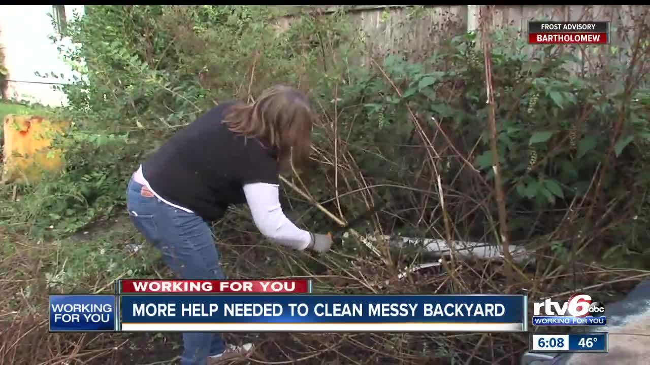 Clean Backyard community members help veteran clean up his backyard