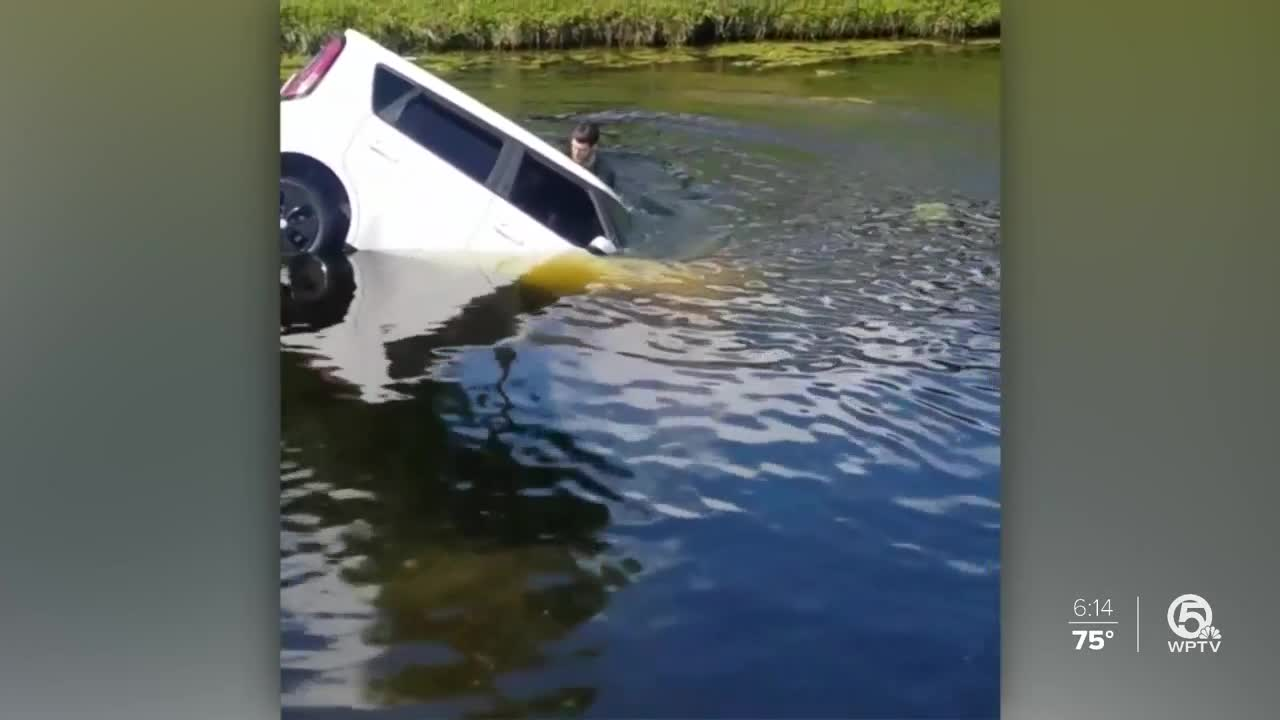 Woman rescued after vehicle plunges into Boca Raton canal
