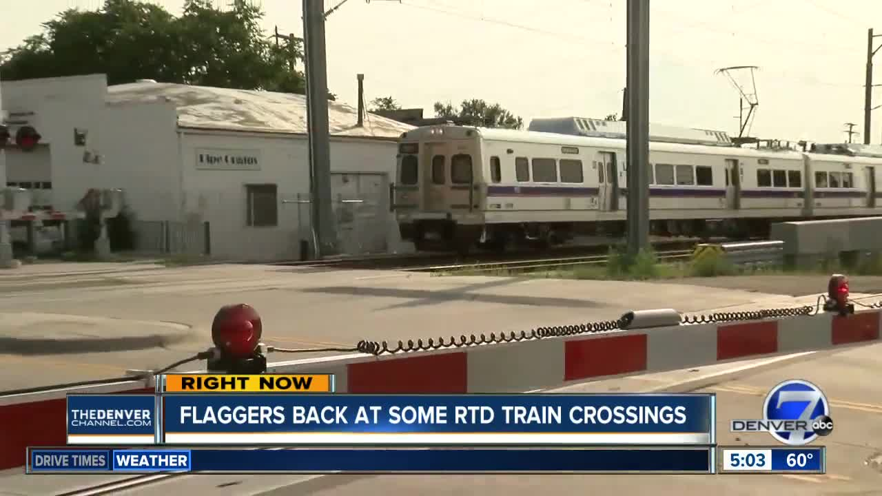 Flaggers return to some RTD crossings after company finds