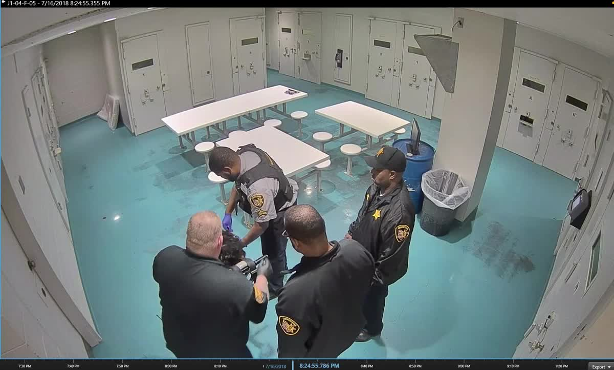 Video shows jailers hit, pepper spray restrained woman