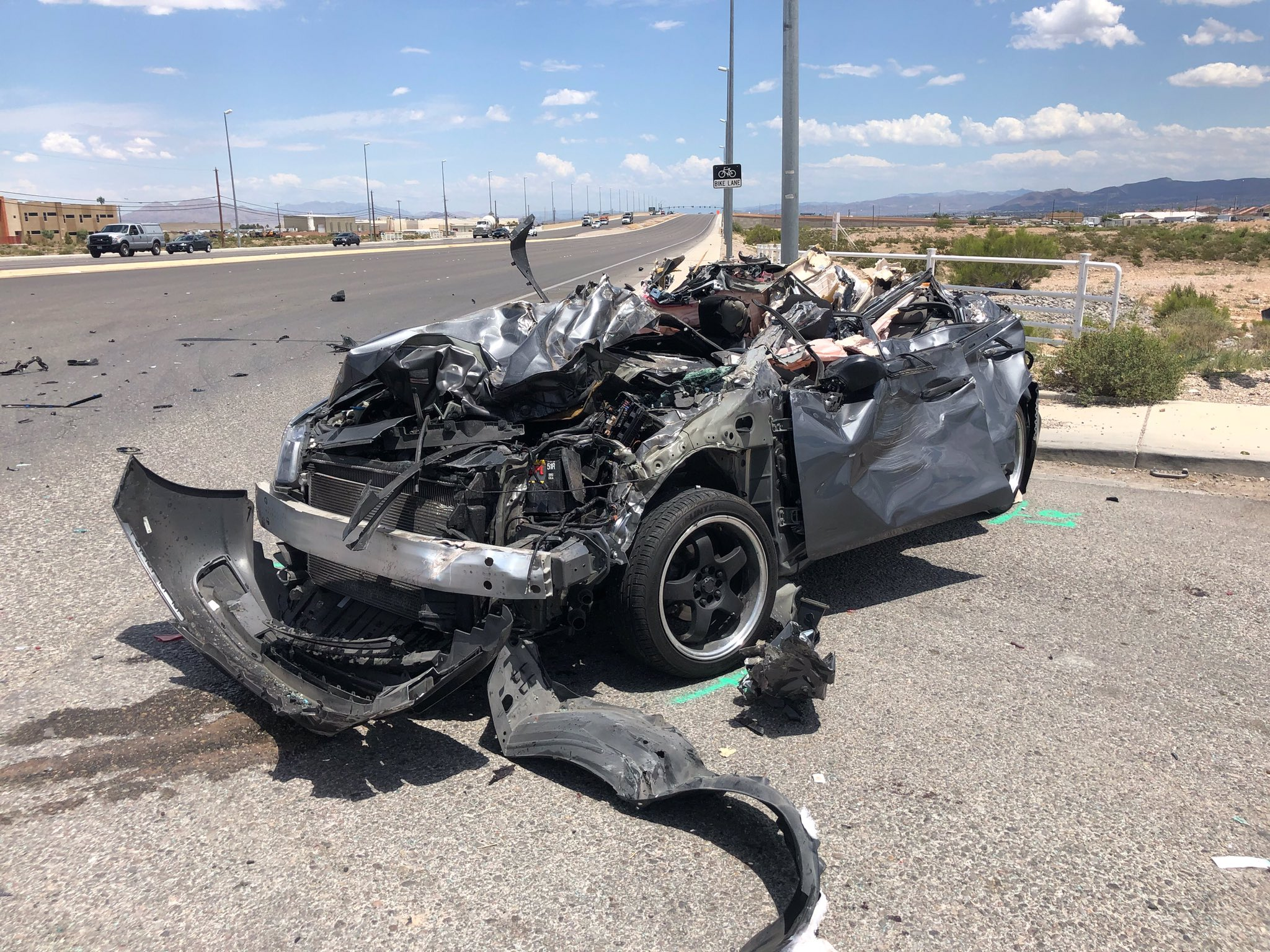 UPDATE: Woman dies after car hits semi on Blue Diamond Road