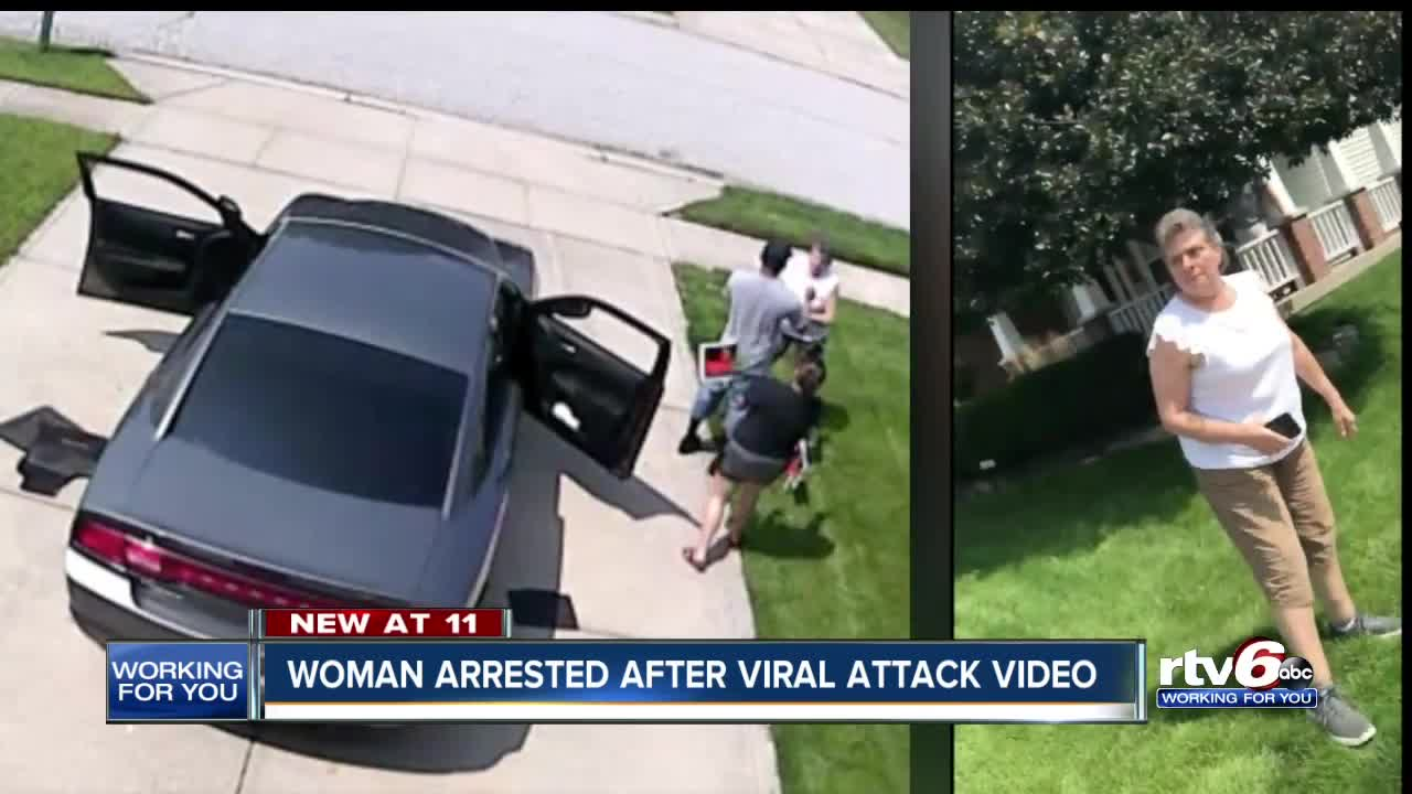 Woman caught on video attacking neighbors with yard signs