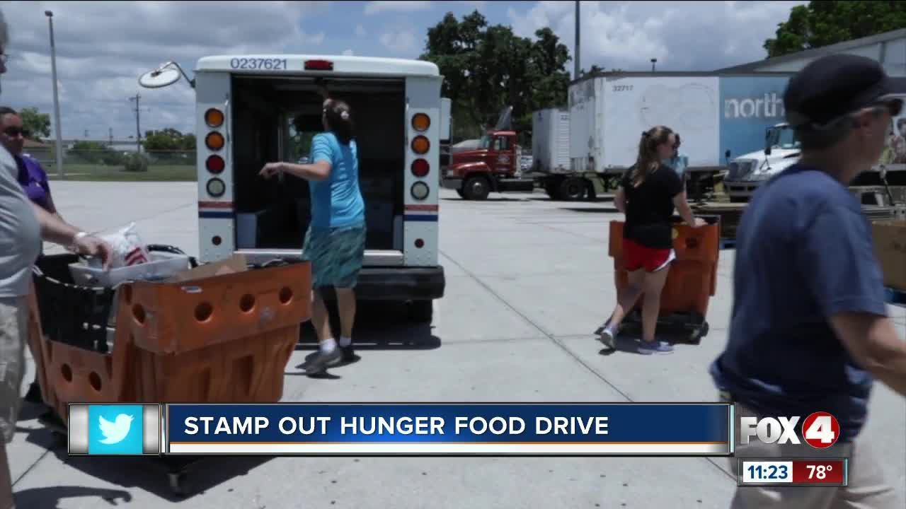 Mail carriers collect donated food to help fight hunger